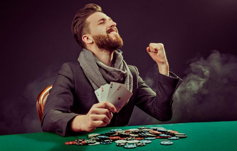 man winning playing baccarat